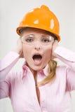 Screaming businesswoman in helmet. Screaming businesswoman in yellow helmet Royalty Free Stock Photo