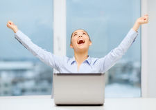 Screaming businesswoman with laptop in office Royalty Free Stock Photos