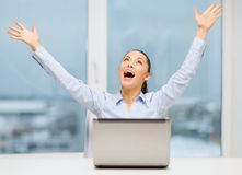 Screaming businesswoman with laptop in office Royalty Free Stock Image
