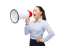Screaming businesswoman with megaphone Stock Images