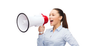 Screaming businesswoman with megaphone Royalty Free Stock Images