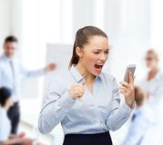 Screaming businesswoman with smartphone Royalty Free Stock Photo