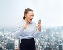 Screaming businesswoman with smartphone Stock Photo