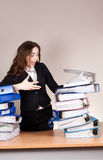Screaming businesswoman with stack of folders at office Stock Image