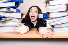 Screaming businesswoman with stack of folders at office Royalty Free Stock Images