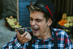 Screaming cellphone. Businessman screaming on the mobile phone Stock Photography