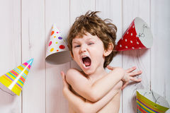 Screaming child in birthday party, cute boy crying. Royalty Free Stock Image
