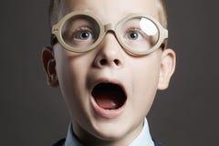 Screaming child in glasses. funny kid stock photo