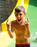 Screaming child on water slide Royalty Free Stock Photography