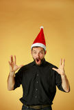The screaming christmas man wearing a santa hat Stock Image