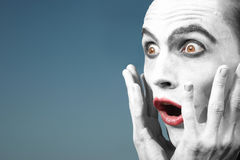 Screaming clown. Screaming crazy funnyman outdoors. Artistic colors added Royalty Free Stock Images
