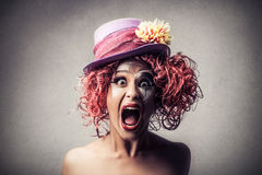 Screaming clown. Woman dressed up as clown screaming Stock Photo