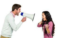 Screaming couple  with man holding loudspeaker Royalty Free Stock Photo
