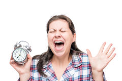 Screaming crazy woman with an alarm clock in her hands Stock Photo