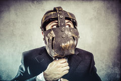 Screaming, dangerous business man with iron mask and expressions Royalty Free Stock Photography