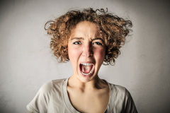 Screaming desperate woman Stock Images