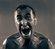 Screaming dirty man Royalty Free Stock Photo