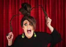 Screaming Drag Queen Pulling Hair. Desperate white drag queen over curtain pulling ponytails Stock Photos