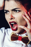 Screaming dramatical woman with red lips Stock Photography