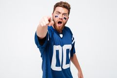 Screaming excited man fan pointing to you. stock image