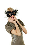 Screaming face. Young attractive female blonde screaming with mask over her face Royalty Free Stock Photography