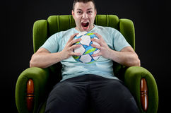 Screaming fan, portrait of angry young man with football ball si Stock Images
