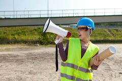 Screaming female architect with megaphone Royalty Free Stock Photography