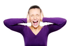 Screaming female face squeeze her ears by hand. Portrait of screaming female face squeeze her ears by hand - isolated on white Royalty Free Stock Image
