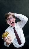 Screaming funny businessman. With gift box Royalty Free Stock Image