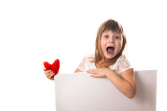 Screaming funny girl with a board for writing  red heart in  han Royalty Free Stock Image