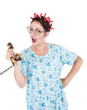 Screaming funny housewife with old telephone. Isolated Stock Images