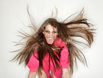 Screaming furious aggressive brunette lady Stock Photo