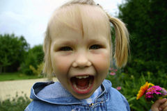 Screaming girl. With flowers in her hand Royalty Free Stock Image