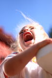 Screaming girl. Little girl is creaming on the playground Stock Image