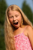 Screaming girl. With long blond hair Stock Photos