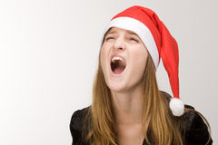 Screaming girl. In red  santa's hat Royalty Free Stock Photo
