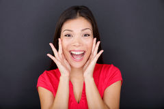 Screaming girl on black background Stock Images