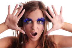Screaming girl with blue eyelashes Royalty Free Stock Photo