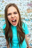 Screaming girl close up face. Stock Photo
