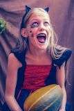 Screaming girl in a costume for Halloween Royalty Free Stock Image