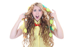 Screaming girl with easter eggs in her hair. Over white Stock Images