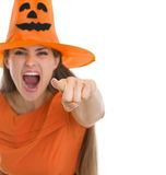 Screaming girl in Halloween hat pointing in camera Stock Photos
