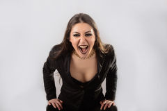 Screaming girl in the jacket with white background Royalty Free Stock Images