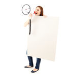Screaming girl with megaphone and blank billboard Stock Photo