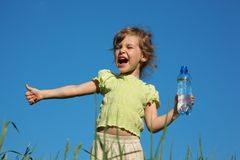 Screaming girl with plastic bottle with water Stock Photo