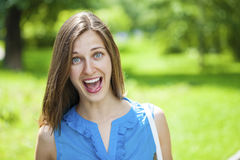 Screaming girl. Portrait of beautiful young happy woman Royalty Free Stock Photography