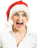 Screaming girl in Santa hat. Stock Image