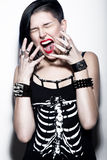 Screaming Girl with shaved head and blue hair in art gothic style with gothic accessories. Royalty Free Stock Image
