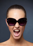 Screaming girl with sunglasses Stock Photo
