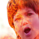Screaming girls burning face - photomanipulation. With using digitally rendered texture Royalty Free Stock Image